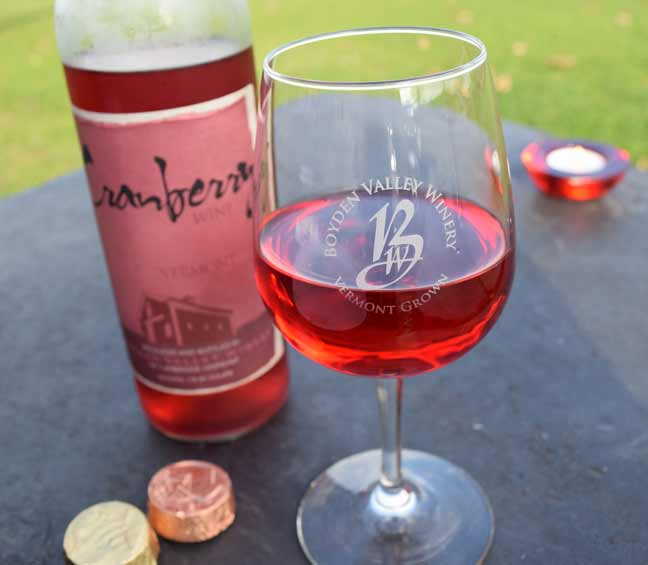 Glass of handcrafted cranberry wine from boyden valley winery