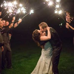 Wedding-couple-kissing-under-sparklers-at-sterling-ridge