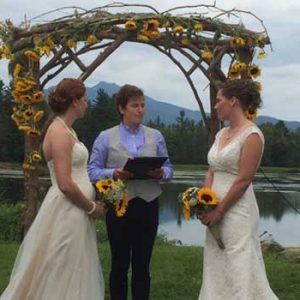 wedding-couple-under-the-arbor-at-large-pond