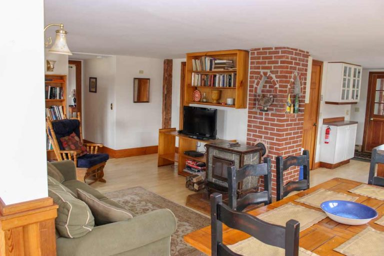 Pond House living area with wood burning stove | Sterling Ridge Resort