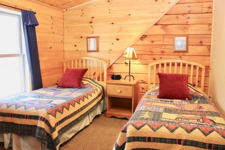 wilderness cabin twins bedroom   Sterling Ridge Resort