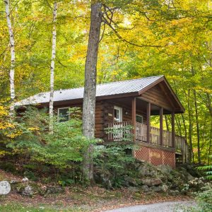 Exterior of a studio cabin during late summer | Sterling Ridge Log Cabin Resort