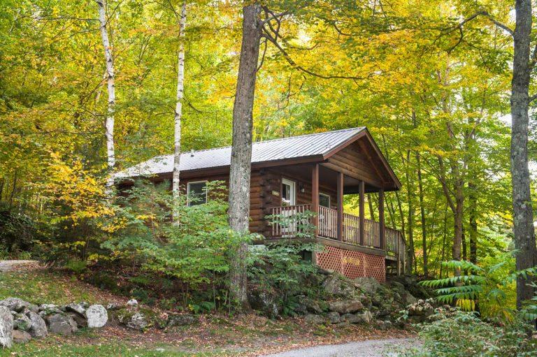 Exterior of a studio cabin during late summer   Sterling Ridge Log Cabin Resort