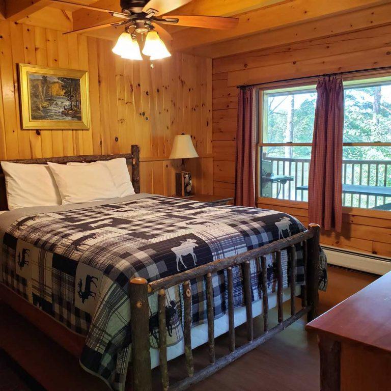 Master bedroom of Field and Stream Dream cabin at Sterling Ridge Resort
